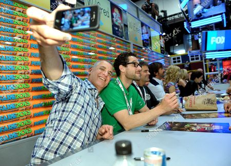 """Stock Picture of From left, producers David Zuckerman, Eli Jorne, Reed Agnew, and cast members Jason Gann, Fiona Gubelmann and Dorian Brown sign autographs at the FX """"Wilfred"""" booth signing on Day 2 of Comic-Con International on in San Diego, Calif"""