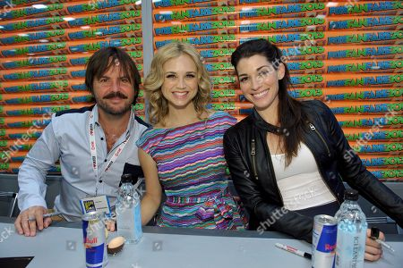 """From left, Jason Gann, Fiona Gubelmann and Dorian Brown sign autographs at the FX """"Wilfred"""" booth signing on Day 2 of Comic-Con International on in San Diego, Calif"""