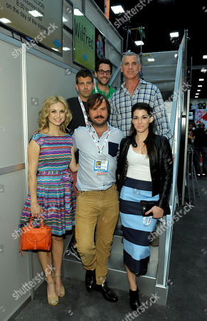 """Stock Image of From left back row, producers Reed Agnew, Eli Jorne, David Zuckerman and from left front row, cast members Fiona Gubelmann, Jason Gann and Dorian Brown attend the FX """"Wilfred"""" booth signing on Day 2 of Comic-Con International on in San Diego, Calif"""