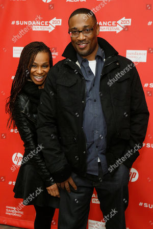 """Director George Tillman Jr., right, and his wife Marcia Tillman pose at the premiere of """"The Inevitable Defeat of Mister and Pete"""" during the 2013 Sundance Film Festival on in Park City, Utah"""