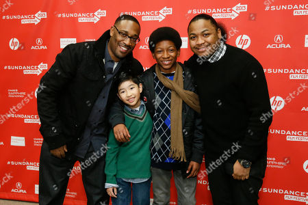 "From left to right, director George Tillman, Jr., and cast members Ethan Dizon, Skylan Brooks, and Julito McCullum pose together at the premiere of ""The Inevitable Defeat of Mister and Pete"" during the 2013 Sundance Film Festival on in Park City, Utah"