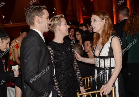 Actress Scarlett Johansson, center, and husband Romain Dauriac share a moment with actress Jullianne Moore at The Independent Film Project's 24th Annual Gotham Independent Film Awards at Cipriani Wall Street, in New York