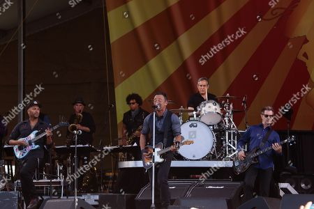 Tom Morello, Bruce Springsteen, Max Weinberg (drums), and Garry Tallent (L-R) and the E Street Band performs at the 2014 New Orleans Jazz & Heritage Festival at Fair Grounds Race Course, in New Orleans