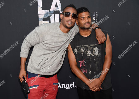 """Actor Marlon Wayans, left, poses with his brother Damien Dante Wayans at the premiere of the film """"Dope"""" at the Los Angeles Film Festival, in Los Angeles"""