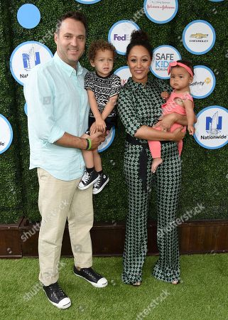 Adam Housley, left, Tamera Mowry, second right, and their children Aden, second left, and Ariah, right, arrive at Safe Kids Day at Smashbox Studios, in Culver City, Calif