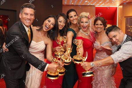 KTLA's Chris Wolfe, from left, Cher Calvin, Angel Kim, Lu Parker, Kimberly Cornell, Christie Leigh and Phil Ige at the L.A. Area Emmy Awards presented at the Television Academy's new Saban Media Center, in the NoHo Arts District in Los Angeles