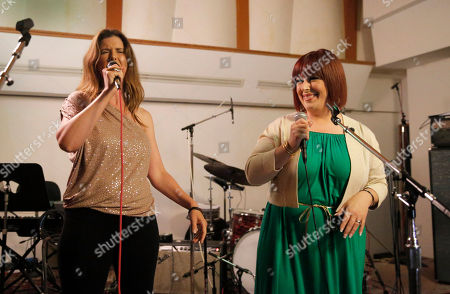 IMAGE DISTRIBUTED FOR CHARITY -Wendy Wilson, left, and Carnie Wilson perform at A Night for Jolie Levine Sponsored by Lupus LA & Sweet Relief Musicians Fund, at Henson Studios on Friday, May, 31, 2013 in Los Angeles
