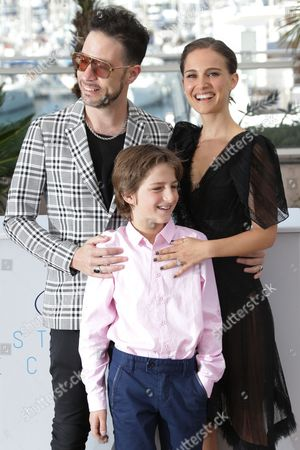 From top left, actor and singer Gilad Kahana, director and actor Natalie Portman and actor Amir Tessler, front, pose for photographers at the photo call for the film A Tale of Love and Darkness, at the 68th international film festival, Cannes, southern France