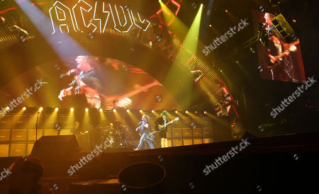 Angus Young, Cliff Williams, Axl Rose and Chris Slade with AC/DC performs at Philips Arena, in Atlanta