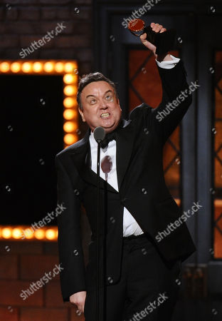 Richard McCabe accepts the award for best performance by an actor in a featured role in a play for the Audience at the 69th annual Tony Awards at Radio City Music Hall, in New York