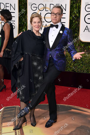Paul Feig, right, and Laurie Karon arrive at the 73rd annual Golden Globe Awards, at the Beverly Hilton Hotel in Beverly Hills, Calif