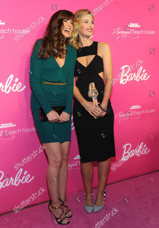 Models Daniela Pestova, right, and Carol Alt attend the Barbie and Sports Illustrated Swimsuit 50th anniversary celebration of the Sports Illustrated Swimsuit legends, in New York