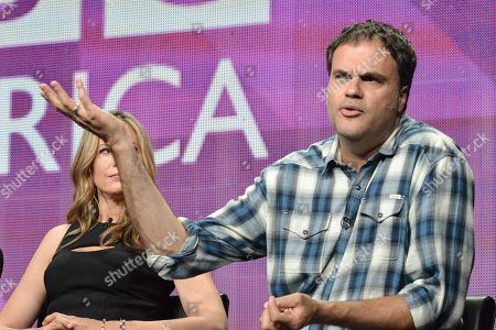 """Mira Sorvino, left, and Eduardo Sanchez speak onstage at the """"The Game"""" portion of the BBC America 2014 Summer TCA, in Beverly Hills, Calif"""