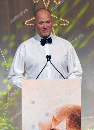 "Screenwriter Jonathan Asser gives his acceptance speech after winning the award for Best British Newcomer for the movie ""Starred Up"" during the 57th BFI London Film Festival Awards Night at Banqueting House Whitehall,, in London"