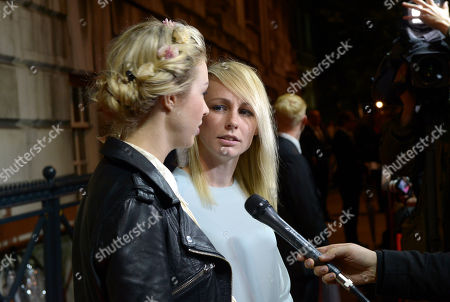 FEMEN activist Alexandra 'Sasha' Shevchenko and director and Australian filmmaker Kitty Green give interviews as they arrive at the 57th BFI London Film Festival Awards Night at Banqueting House Whitehall,, in London