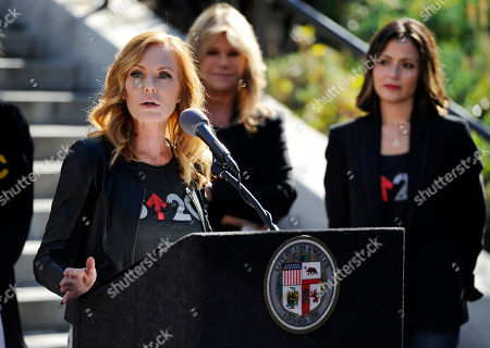"Actress and Stand Up to Cancer ambassador Marg Helgenberger addresses reporters as Council of Founders and Advisers member Lisa Paulsen, second from right, and actress Italia Ricci look on during a news conference to announce Friday, September 5 as ""Stand Up To Cancer Day"" outside Los Angeles City Hall, in Los Angeles"