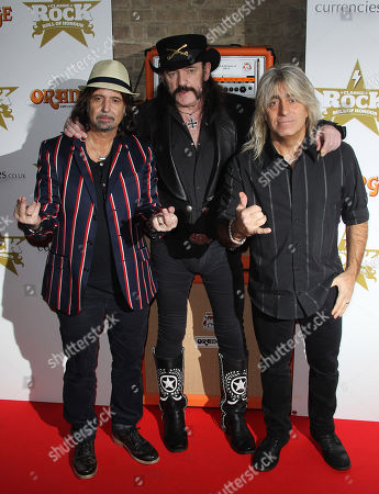 Phil Campbell, left, Lemmy Kilmister, centre, and Mikkey Dee, of Motorhead, arrive for the Classic Rock Roll Of Honour Awards at the Roundhouse venue in Camden, north London