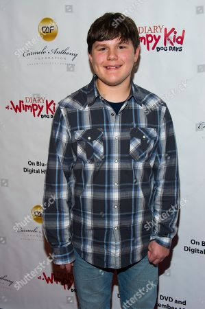 """Stock Image of Actor Robert Capron poses on the red carpet to celebrate the """"Diary of a Wimpy Kid: Dog Days"""" Blu-ray debut on December 18th, at an exclusive screening event held on in New York. Hosted by Twentieth Century Fox Home Entertainment and the Carmelo Anthony Foundation, the family fun event took place at the AMC Empire 25 Theater"""