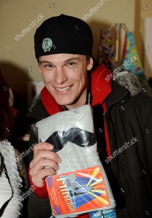 Actor Grant Harvey visits House of Minerva handmade accessories at the Fender Music lodge during the Sundance Film Festival, in Park City, Utah