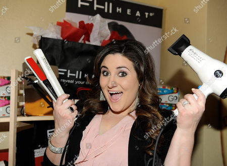 Actress KayCee Stroh holds FHI HEAT hair tools at the Fender Music lodge during the Sundance Film Festival, in Park City, Utah