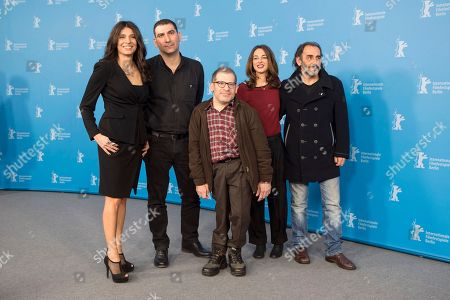 Stock Image of From left, actress Popi Tsapanidou, director Yannis Economides, actors Petros Zervos, Vicky Papadopoulou and Vangelis Mourikis pose for photographers at the photo call for the film Stratos during the 64th Berlinale International Film Festival, in Berlin