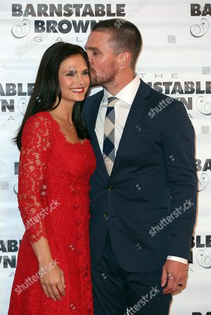 Stephen Amell and wife Cassandra Jean attends the G.H. Mumm Champagne event at the Barnstable Brown Gala, in Louisville, Ky