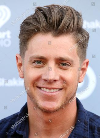 Stock Image of Jef Holm arrives at the iHeartRadio Album Release Party for Shakira's Target Exclusive Deluxe Edition in Burbank, Calif. on