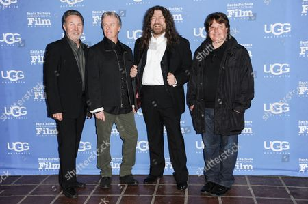 From left, Manager Budd Carr, drummer Phil Ehart and vocalist Robby Steinhardt of Kansas with director Charley Randazzo arrive at the 30th Santa Barbara International Film Festival Montecito Award ceremony, in Santa Barbara, Calif