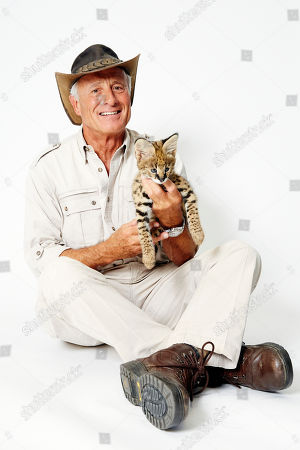 Jack Hanna poses for a portrait with a baby serval on in New York