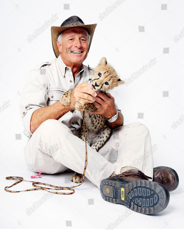 Jack Hanna poses for a portrait with a baby cheetah on in New York