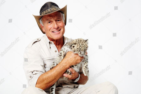 Jack Hanna poses for a portrait with a baby snow leopard on in New York