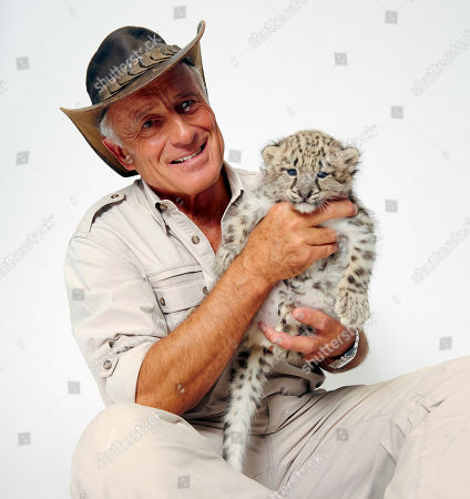 Wildlife advocate Jack Hanna poses for a portrait with a snow leopard cub on in New York