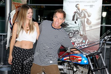"""Dave England, right, and Johanna England arrive at the LA Premiere of """"Being Evel"""" at ArcLight Cinemas, in Los Angeles"""