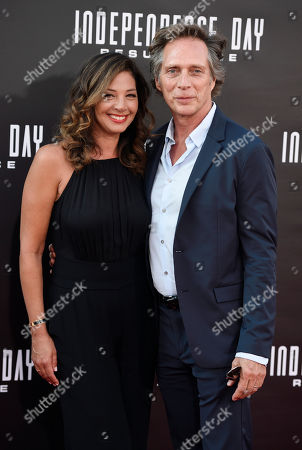 """Stock Picture of William Fichtner, a cast member in """"Independence Day: Resurgence,"""" poses with his wife Kymberly Kalil at the premiere of the film at the TCL Chinese Theatre, in Los Angeles"""