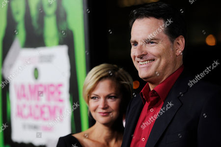 """Stock Picture of Mark Waters, director of """"Vampire Academy,"""" poses with his wife Dina at the premiere of the film, in Los Angeles"""