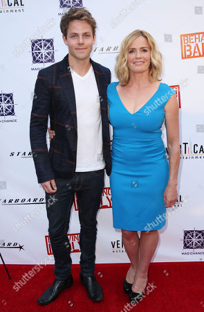 "Elisabeth Shue, left, and Lachlan Buchanan pose together at a special screening of ""Behaving Badly"" on in Los Angeles"