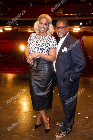 """NeNe Leakes and Gregg Leakes pose on stage after her debut performance in Broadway's """"Cinderella"""" on in New York"""