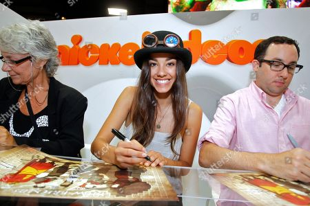 Actress Seychelle Gabriel and actor P. J. Byrne sign autographs for The Legend of Korra fans at Nickelodeon during Comic-Con, in San Diego, Calif
