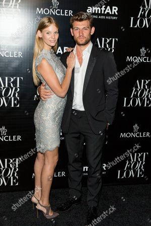 """Marloes Horst, left, and guest attend the NYFW Spring/Summer 2016 â?"""" Monclear and amfAR celebrate art for LOVE at The New York Public Library, in New York"""