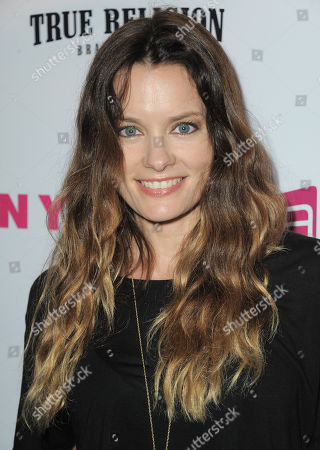 Stock Image of Actress Gina Holden arrives at the Nylon Magazine: Summer Music Issue Celebration on in Los Angeles, Calif