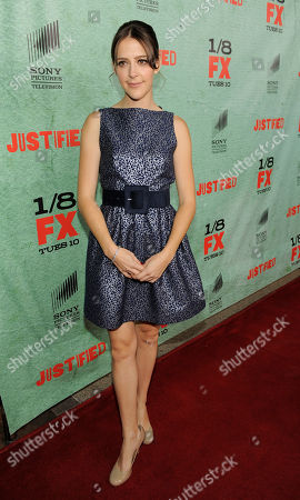 """Abby Miller, a cast member in the FX series """"Justified,"""" poses at the show's fourth season premiere screening at Paramount Theatre, in Los Angeles"""