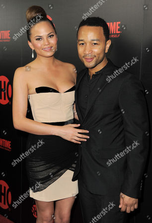 Stock Image of John Legend, right, and Chrissy Tiegan attend the Showtime Emmy Eve Soiree at the Sunset Tower Hotel, in Los Angeles