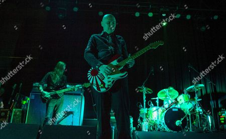 Stock Image of Mark Stoermer of The Killers performs with Billy Corgan and Brad Wilk of Rage Against the Machine, as part of the special new line-up of the Smashing Pumpkins at Thalia Hall on in Chicago