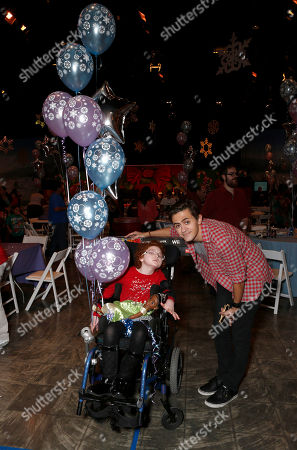 Starlight Kid Joesphine Wells Age 8 and Rob Pinkston attend the Starlight Winter Wonderland presented by Northwestern Mutual on in Los Angeles, California