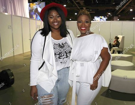 Avery Sunshine and Jazmine Sullivan pose backstage during the Steve Harvey Morning Show live broadcast at the Georgia World Congress Center, in Atlanta