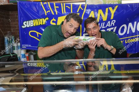 SUBWAY Famous Fans Mike Golic, left, and Mike Greenberg, of ESPN, pose behind the counter at a SUBWAY restaurant in New York, as part of the FOOTLONGS and Football ANYone? event celebrating SUBtember, where any regular footlong sandwich is $5 all month long