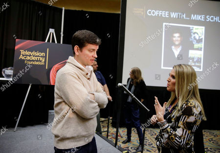 """Emmy  Award-winning writer/producer Mike Schur, left, speaks with educators and students following BEA's """"Coffee With...Mike Schur,"""" presented by the Television Academy Foundation on in Las Vegas"""