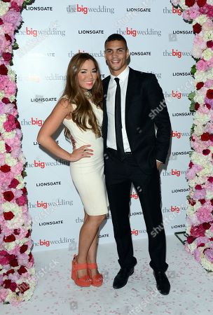 Stock Image of Casey Wicks and Anthony Ogogo arriving for a VIP screening of The Big Wedding at the Mayfair Hotel in London on