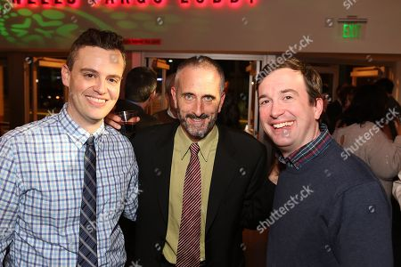 "Stock Picture of From left, playwright Bobby Mort, CTG Associate Artistic Director Neel Keller and playwright Peter Gwinn pose during the party for the opening night performance of The Second City's ""A Christmas Carol: Twist Your Dickens!"" at the Center Theatre Group's Kirk Douglas Theatre, in Culver City, Calif"
