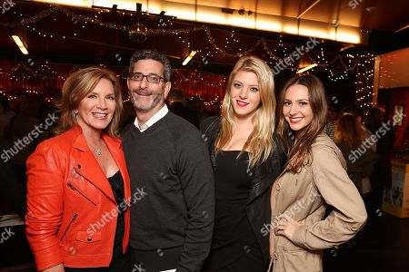 """From left, CTG Artistic Director Circle member Donna McKenna, Flynn Chernos, McKenna Stutz and Nicolle Wyatt pose during the party for the opening night performance of The Second City's """"A Christmas Carol: Twist Your Dickens!"""" at the Center Theatre Group's Kirk Douglas Theatre, in Culver City, Calif"""